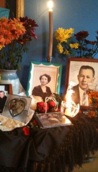 Juana's Día de Los Muertos altar with pictures of her mother and father.