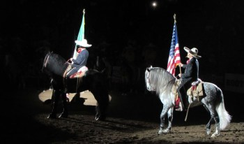 Roberto Torres & Roberto Torres Jr. representing Escaramuza Descendencia Charra carry to American & Mexican Flags to start the rodeo spectacular