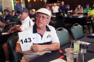 Gene Lucero makes the winning bid on a Colorado Rockies suite worth 2,500