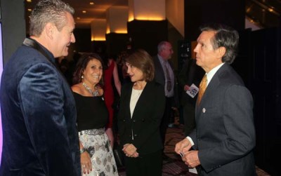 From L-toR, Denver Police Chief , His mother Stella Madrid-Intergovernmental & Community Affairs Officer for DHA, Cindy Pena with husband and former Denver Mayor Federico Pena