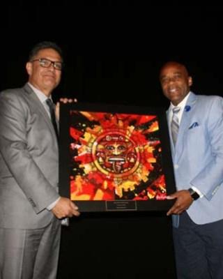 "Denver Mayor Michael Hancock receives the ""Community Builder Award"" from Rudy Gonzales"