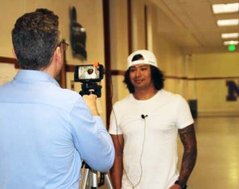 A.J. Anaya interviewed by Channel 2 News Anchor Chris Parente in the halls of Denver's North High School. Photo by Latin Life Denver Media