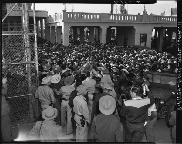 """Mexican workers await legal employment in the United State,"" Mexicali, 1954 (Public Domain)"