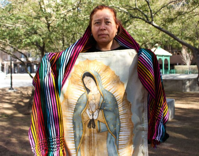 Sandra Torres, from San Antonio, holds an image of the Virgen de Guadalupe and a shawl made by women from Juárez. (Maria Equinca)