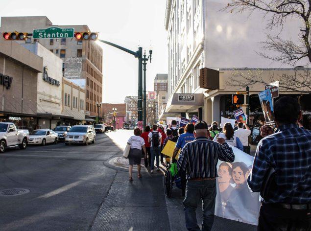 A delegation walks through Downtown El Paso. (Maria Esquinca)