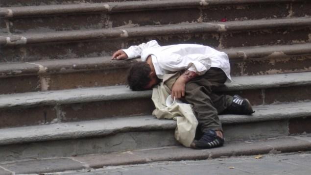A homeless man on the steps of the Cathedral of San Juan Bautista in San Juan, Puerto Rico (Hernan Bustelo/Flickr)