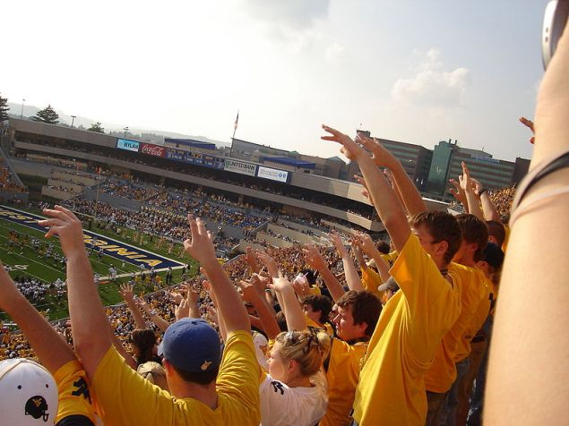 Students cheering at West Virginia University football game (Photo by Swimmerguy269)