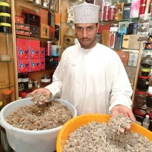 People - Omani man presenting different types of frankincense luban_incense, Al Husn Souq, Salalah, Dhofar, Oman