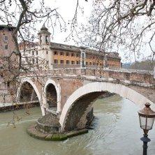 The bridge to the Tiberina Island. The Tiber River in Rome, Italy.