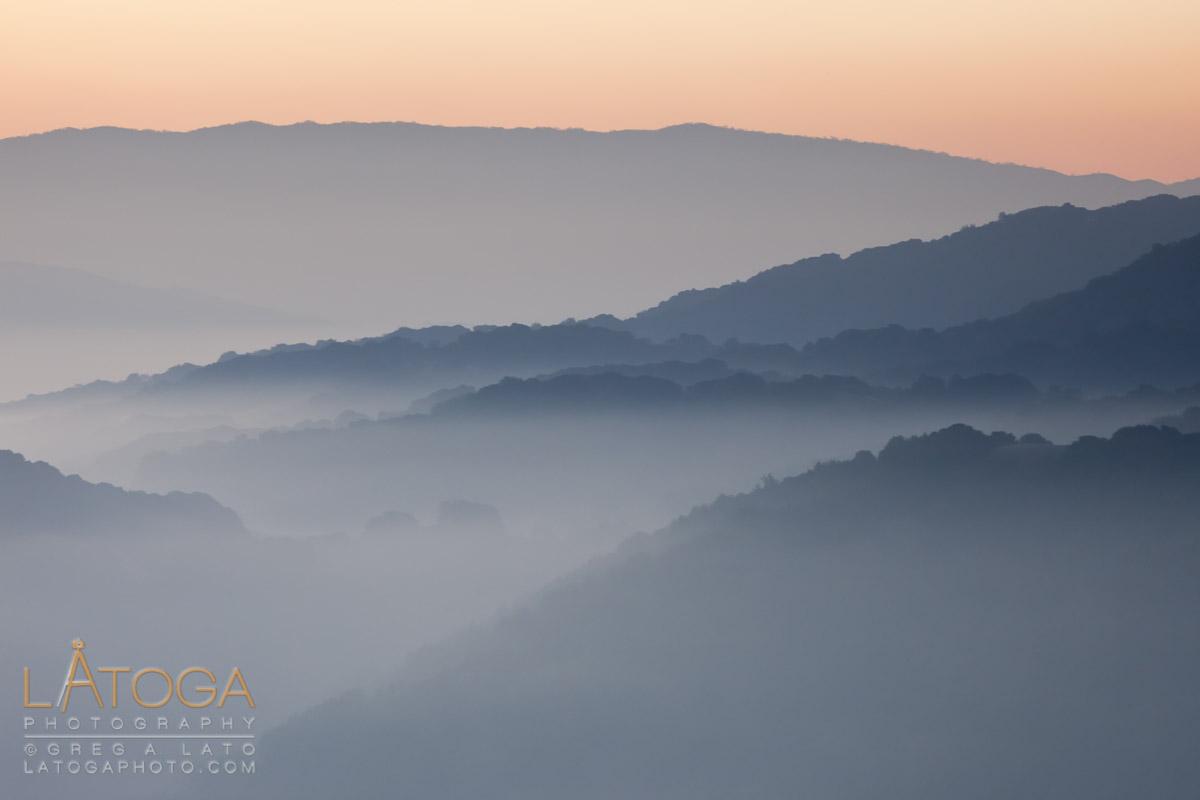 Early morning lights falls on fog covered Dublin Hills, part of the East Bay Regional Park in Dublin, California