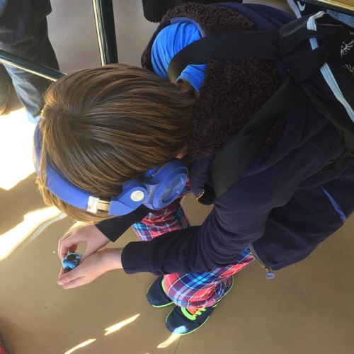 child playing with fidget cube - sensitive child thrill-seeker - laugh love learn
