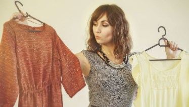 deciding clothes clearing out closet