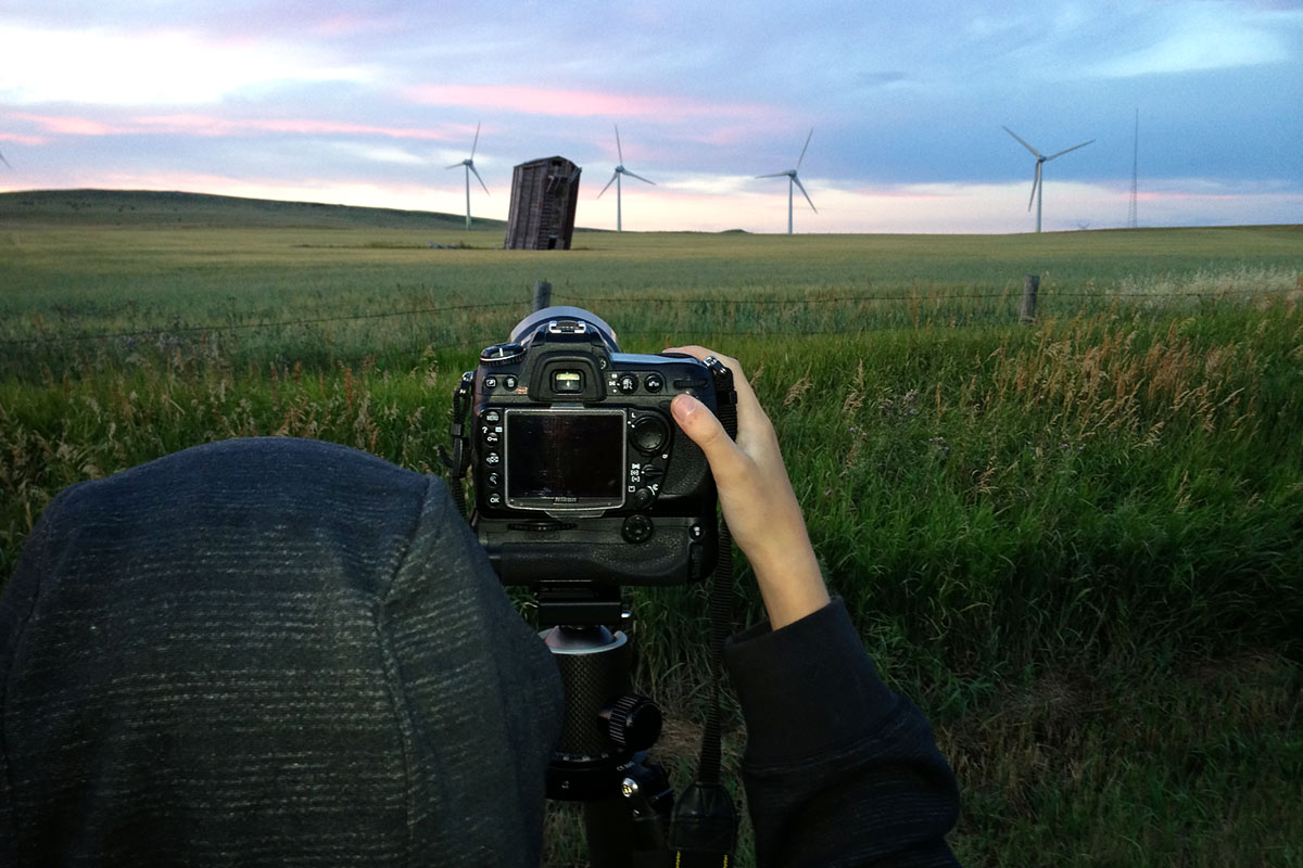 Marlise squeezing the shutter on her camera on this iconic southwestern Alberta scene.