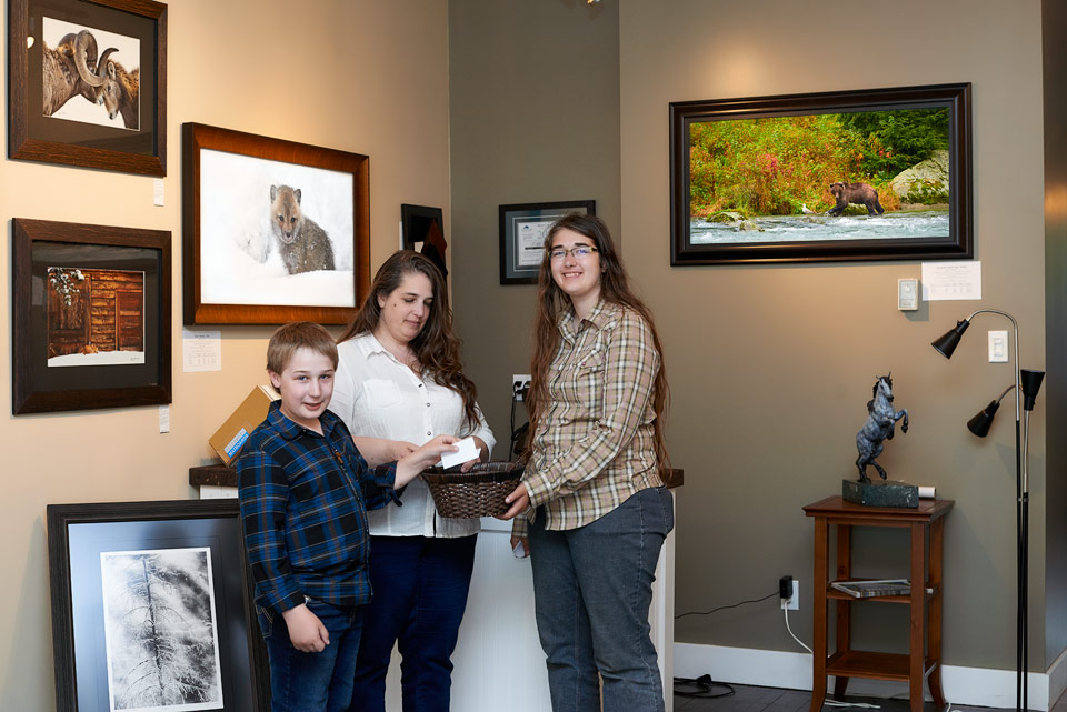 Josiah draws a winner in our Grand Opening giveaway of art card packs and a signed print at the Launstein Imagery Wildlife Art Gallery in Crowsnest Pass, Alberta.