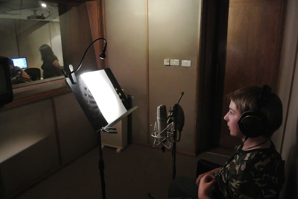 Josiah in the recording studio adding voice overs for alternate versions of the film and additional interview spots.