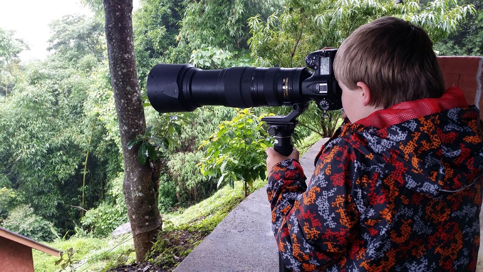 Josiah photographing caterpillars off the deck of our lodge in high in the mountains of northern Thailand.