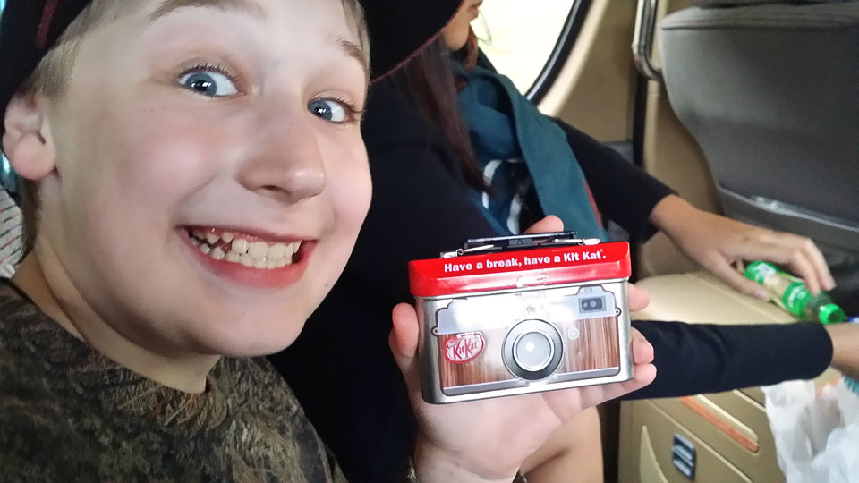 Josiah with his new backup camera, an appropriately-packaged Kit Kat chocolate bar!