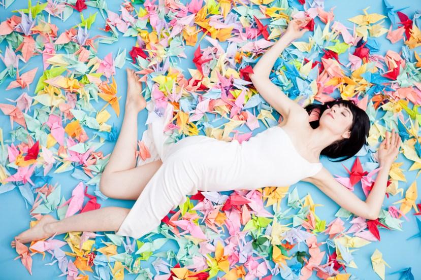 Laüra Hollick with Rainbow Paper Cranes