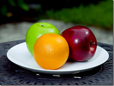 fresh apples and orange fruit on plate