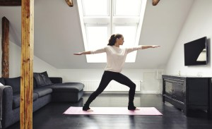 woman-white-sweatshirt-black-yoga-pants-practicing-home-05152015