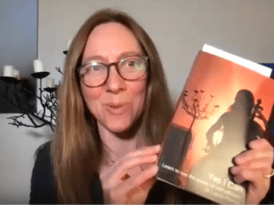 Laura holding a copy of her book