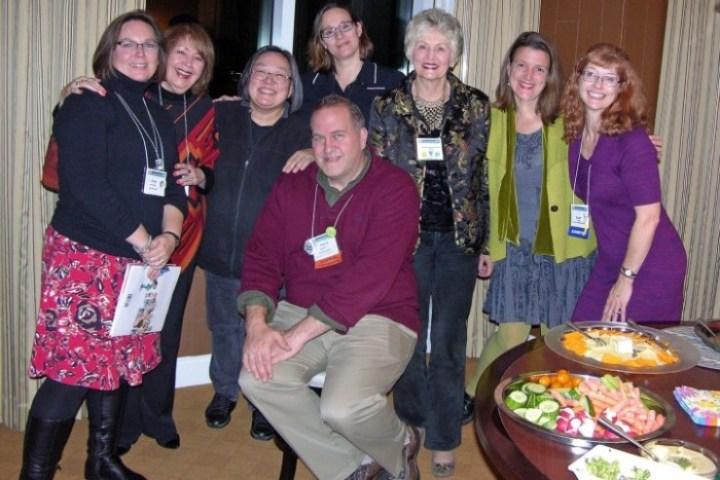 Heidi Mordhorst (l.), Pat Mora, Janet Wong, Tricia Stohr-Hunt, Joan Bransfield Graham, Amy Ludwig VanDerwater, Laura Purdie Salas, Paul Hankins (seated)