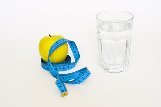 weight loss tape, apple and water