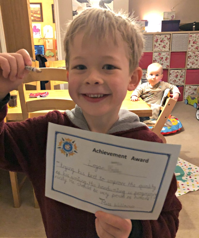 Logan with his reading certificate