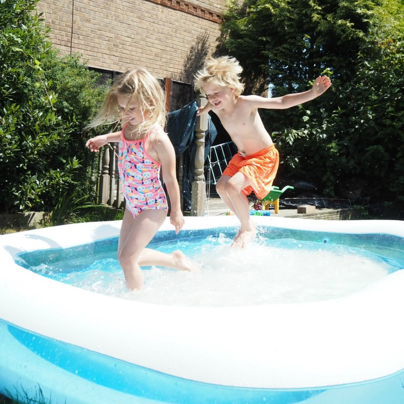 Free or Cheap Things to do in the Summer Holidays - Aria and Logan playing in the paddling pool