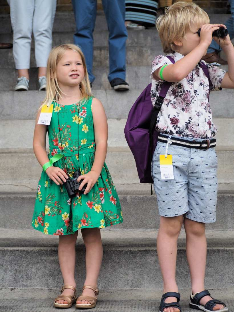 Logan and Aria watching the races