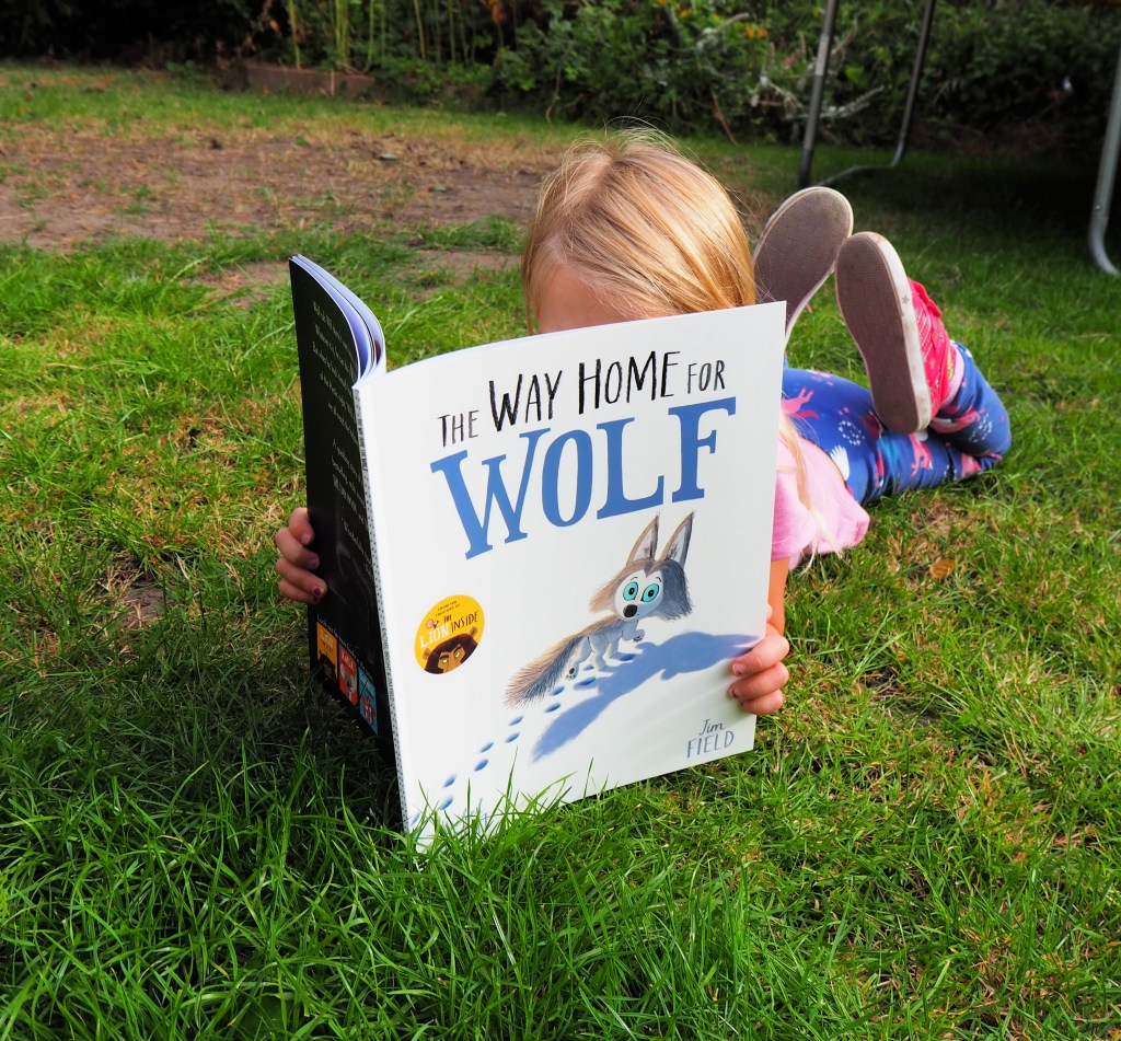 The Way of the Wolf book review - Aria lying on the grass