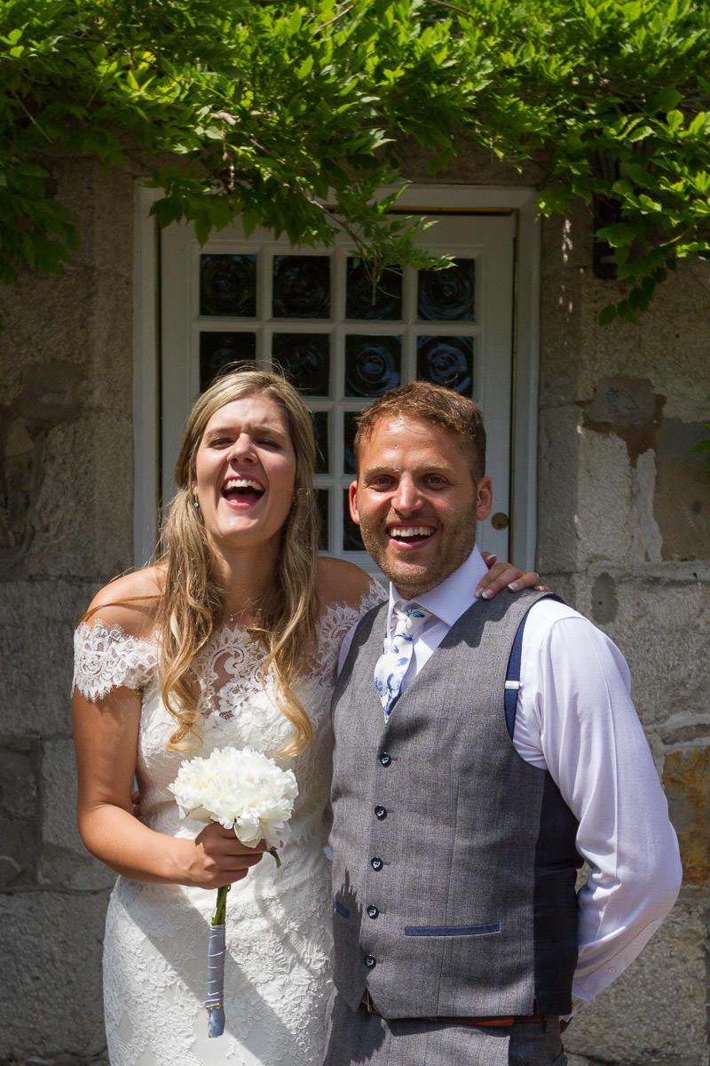Newly weds at Tros Yr Afon in Beaumaris, Wales by wedding