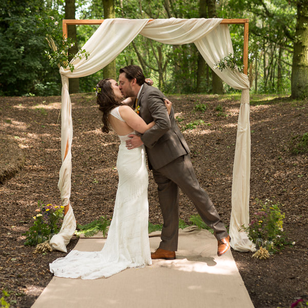 bride and groom kissing at outdoor sherwood forest wedding venue