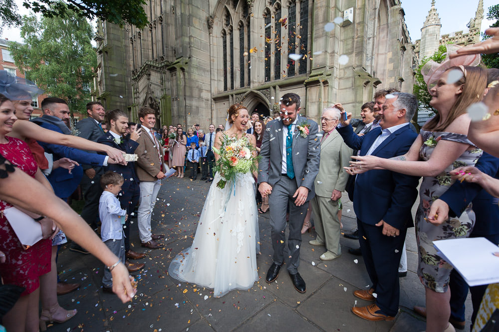 Confetti thrown at Newly weds at St Mary's Church Nottingham Wedding Venue