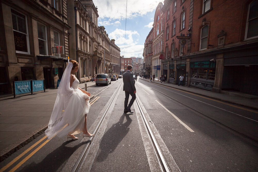 Bride and groom walk to the Nottingham Council House, Nottingham Wedding venue