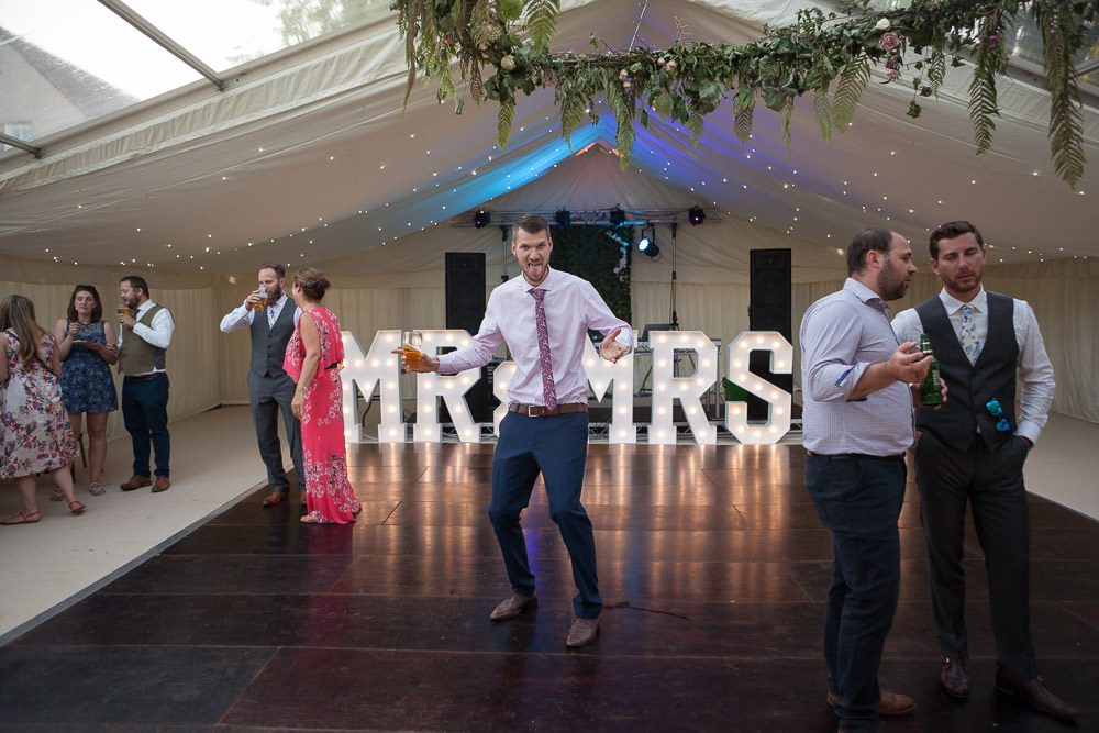 Guests dancing on dance floor at Tros Yr Afon wedding venue, DIY castle wedding