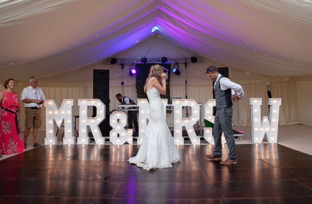 newly weds first dance at Tros Yr Afon wedding venue, DIY Beaumaris castle wedding