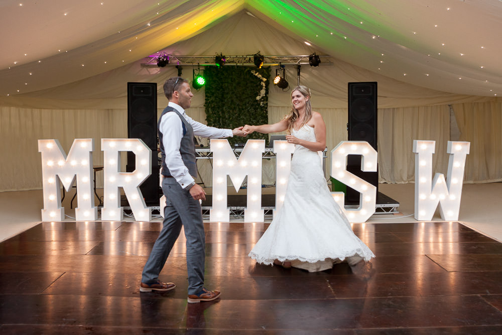 newly weds have their first dance at Tros Yr Afon wedding venue, DIY Beaumaris castle wedding