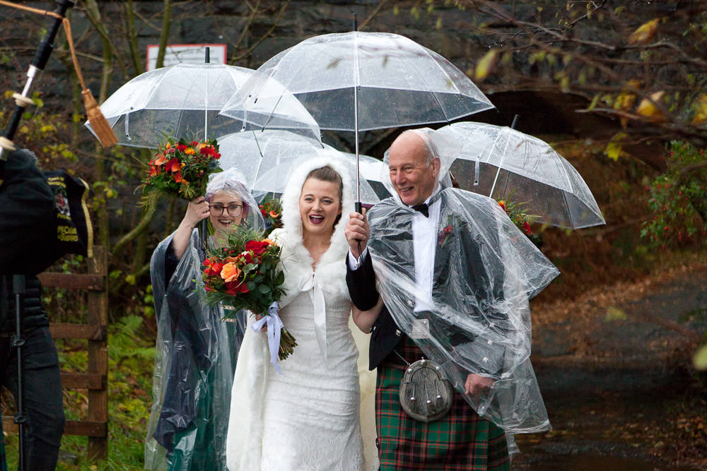 bride first sees her husband to be down to the beach ceremony at Isle of Skye wedding
