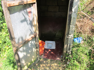outhouse open door