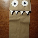 a photo of a paper bag puppet with fangs