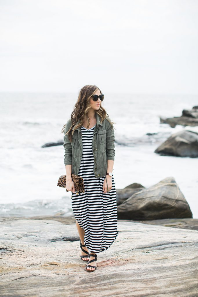 Striped maxi dress styled with a cargo vest for spring