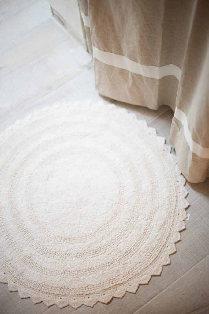 Simple round ivory bath mat from World Market