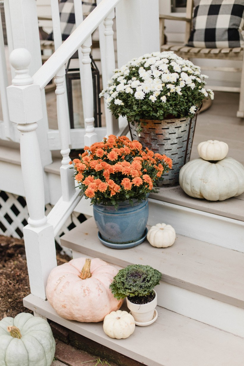 Life and style blogger Lauren McBride shares her Fall Front Porch featuring a mix of natural and vintage elements as well as outdoor lanterns with flameless candles.