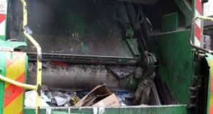 Le compacteur d'un camion-poubelle
