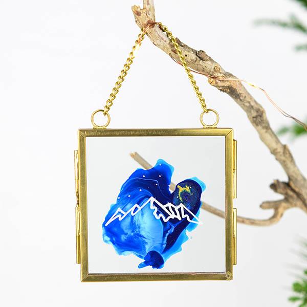 Glas ornament met berg