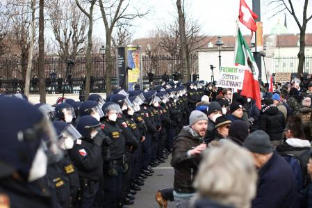 Police officers line up as people gather during a demonstration against the coronavirus disease (COVID-19) measures and their economic consequences in Vienna, Austria, January 31, 2021. REUTERS/Lisi Niesner