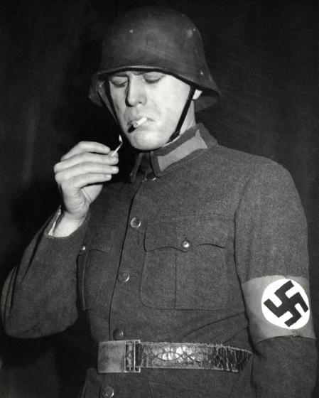 (Original Caption) Nazi smoking a cigarette. Undated photograph.