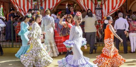 Seville, Spain - May 03, 2017: People taking a walk and enjoying at the Seville's April Fair.