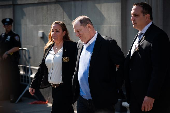 Harvey Weinstein is escorted by police in New York city.